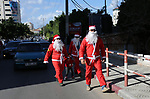 Palestinians dressed as Santa Claus celebrate to welcome the new year, in the streets of Gaza City, New Year's Eve revellers on December 31, 2017. Photo by Ashraf Amra