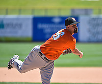 Fresno Grizzlies starting pitcher Mike Hauschild (46) delivers a pitch to the plate against the Salt Lake Bees in Pacific Coast League action at Smith's Ballpark on June 14, 2015 in Salt Lake City, Utah.  (Stephen Smith/Four Seam Images)