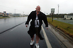 Journal photo by Ted Richardson:  9/18/2003  Craig Kirk walks backwards along Hwy 158 in Kitty Hawk during Hurricane Isabel to keep the blowing rain and sand out of his face.  His car had gotten stuck on a flooded road near his flooring store.  He needed to walk three miles back to his house further south along the highway. m CIT 19 isabel 33 ric .jpg.