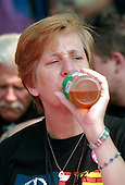Washington, D.C. - July 4, 2006 -- Anti-war activist Cindy Sheehan drinks apple juice during day 1 of her hunger strike against Operation Iraqi Freedom in Lafayette Park across from the White House in Washington, D.C. on July 4, 2006..Credit: Ron Sachs / CNP