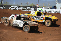Apr 17, 2011; Surprise, AZ USA; LOORRS driver Josh Merrell (22) races alongside Aaron Daugherty (24) during round 4 at Speedworld Off Road Park. Mandatory Credit: Mark J. Rebilas-