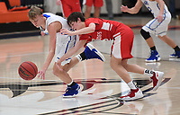 NWA Democrat-Gazette/J.T. WAMPLER Rogers' Will Liddell steals the ball from Carl Junction's Isaac Hoberecht Thursday Dec. 6, 2018 at the Arvest HoopFest at Heritage High School in Rogers. Rogers won 54-50.