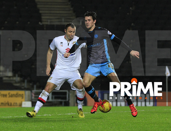 Kieran Lee of Sheffield Wednesday back heels the ball during the Sky Bet Championship match between MK Dons and Sheff Wednesday at stadium:mk, Milton Keynes, England on 15 December 2015. Photo by Liam Smith.