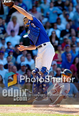 2 July 2005: Michael Barrett, catcher for the Chicago Cubs, leaps to stop an offline throw to the plate, while Brad Wilkerson slides home safely during a game against the Washington Nationals. The Nationals defeated the Cubs 4-2 in front of 40,488 at Wrigley Field in Chicago, IL. Mandatory Photo Credit: Ed Wolfstein