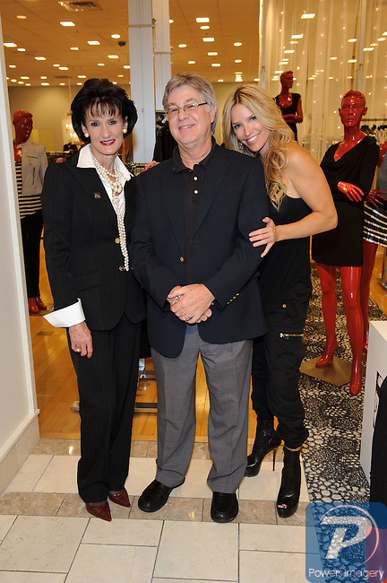 Mari Landers, Craig Dickson, Heidi Cornell at the Fashion Night out event at Saks 5th Avenue store located in the Fashion Show Mall, Las Vegas, NV, September 10, 2010 © Al Powers / Vegas Magazine
