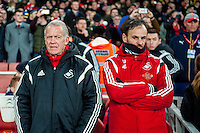 Alan Curtis, First-team coach of Swansea City looks on during the Barclays Premier League match between Arsenal and Swansea City at the Emirates Stadium, London, UK, Wednesday 02 March 2016