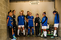 Seattle, WA - Sunday, September 24th, 2017: Megan Rapinoe, Lauren Barnes, Sydney Leroux Dwyer and Becky Sauerbrunn stood inside the player tunnel during the national anthem, prior to a regular season National Women's Soccer League (NWSL) match between the Seattle Reign FC and FC Kansas City at Memorial Stadium.