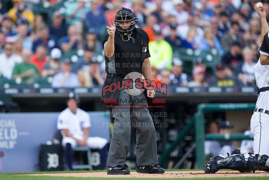 Home plate umpire Mark Carlson makes a strike call during the Major League Baseball game between the Chicago White Sox and the Detroit Tigers at Comerica Park on June 2, 2017 in Detroit, Michigan.  The Tigers defeated the White Sox 15-5.  (Brian Westerholt/Four Seam Images)