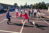 RECESS AT ELEMENTARY SCHOOL.PLAYGROUND ACTIVITIES. PLAYING FOURSQUARE. ELEMENTARY SCHOOLSTUDENTS. OAKLAND CALIFORNIA USA CARL MUNCK ELEMENTARY SCHOOL.