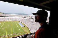 Ryan McFadden watches the lightning during a rain delay in the first half of the Virginia/Brigham Young game in Charlottesville, Va. Virginia defeated Brigham Young 19-16. Photo/Andrew Shurtleff