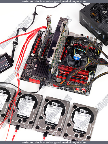 Computer motherboard with four hard drives connected to a RAID controller