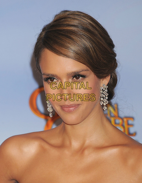 Jessica Alba .Press Room at the 69th Annual Golden Globe Awards held at the Beverly Hilton Hotel, Hollywood, California, USA..January 15th, 2012.globes headshot portrait dangling earrings strapless silver .CAP/GDG.©GDG/Capital Pictures