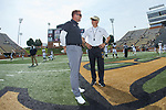 Wake Forest Demon Deacons head coach Dave Clawson (right) chats with Towson Tigers head coach Rob Ambrose prior to the start of their NCAA football game at BB&T Field on September 8, 2018 in Winston-Salem, North Carolina. The Demon Deacons defeated the Tigers 51-20. (Brian Westerholt/Sports On Film)
