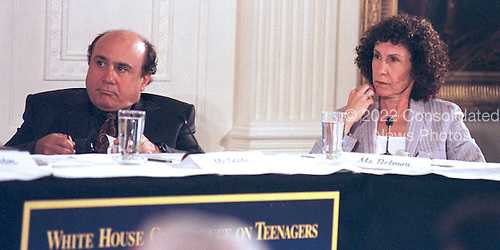 "Danny DeVito and Rhea Perlman listen to First Lady Hillary Rodham Clinton's  opening remarks at the ""White House Conference on Teenagers: Raising Responsible and Resourceful Youth"" in Washington, DC on 2 May, 2000.<br /> Credit: Ron Sachs / CNP"