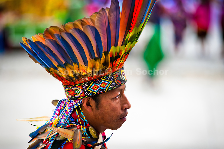 "A Colombian Kamentsá native, wearing a colorful feather headgear, takes part in the Carnival of Forgiveness, a traditional indigenous celebration in Sibundoy, Colombia, 12 February 2013. Clestrinye (""Carnaval del Perdón"") is a ritual ceremony kept for centuries in the Valley of Sibundoy in Putumayo (the Amazonian department of Colombia), a home to two closely allied indigenous groups, the Inga and Kamentsá. Although the festival has indigenous origins, the Catholic religion elements have been introduced and merged with the shamanistic tradition. Celebrating annually the collaboration, peace and unity between tribes, they believe that anyone who offended anyone may ask for forgiveness this day and all of them should grant pardons."