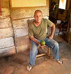 A small farmer with a fresh avocado in the Topes de Collantes mountains, between Trinidad and Cienfuegos, Cuba