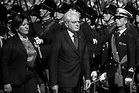 """Sergio Mattarella (President of the Italian Republic) & Elisabetta Trenta (Minister of Defence). <br /> <br /> Rome, 02/06/2019. Today, Italy celebrated the annual """"Festa Della Repubblica"""" (Republic Day, 1.). The 73rd Anniversary of the Italian Republic (*) was marked with the """"Raising the Flag Ceremony"""" and the tribute to the Sacello del Milite Ignoto (Unknown Soldier) at the Altare della Patria """"Vittoriano"""" (2.) by the President of the Italian Republic Sergio Mattarella, followed by the traditional army, veterans and civilians parade along Via Dei Fori Imperiali. This year, the President of the Republic was accompanied by the Defence Minister Elisabetta Trenta, the Italian Prime Minister Giuseppe Conte, the Presidents of the two Chambers of the Parliament, Roberto Fico and Maria Elisabetta Alberti Casellati, several members of the Italian Government, political leaders, senior officers of the Armed Forces and representatives of the Civilian Organizations. At the end of the events the Frecce Tricolori, the Italian Aerobatic Team, coloured the sky over Rome with the Tricolore (Tricolour: Green, White, Red) of the Italian Flag. The theme for this year's event was inclusiveness. <br /> <br /> Footnotes and Links:<br /> (*) The Referendum was held on 2 June 1946 and it marked the decision made by the Italian people to adopt the Republic as the new institutional form for the Country. <br /> 1. http://bit.do/eT8By (ITA) & http://bit.do/eT8Bv (ENG) at https://www.difesa.it/<br /> 2. http://bit.do/eT8BG (Wikipedia)"""