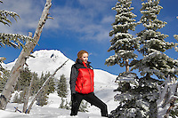 Woman near Timberline Lodge in winter with Mt. Hood.Oregon