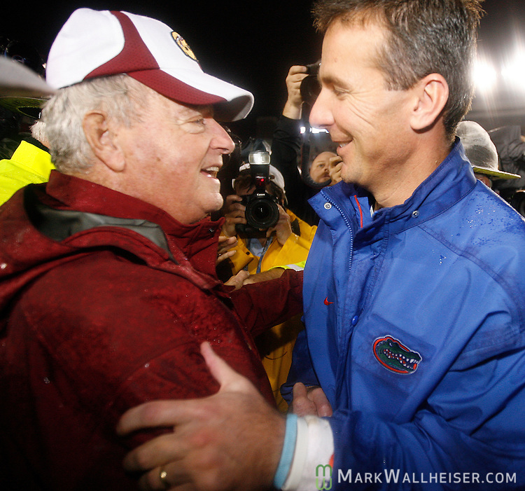 Seminole head coach Bobby Bowden (L) and Gator head coach Urban Meyer meet at mid-field after the Florida Gators defeated the FSU Seminoles 45-15 on a rainy night at Bobby Bowden Field in Tallahassee, Florida November 29, 2008.   (Mark Wallheiser/TallahasseeStock.com)