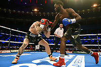 Denzel Bentley (blue gloves) defeats Kelcie Ball during a Boxing Show at the Royal Albert Hall on 27th September 2019