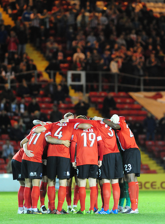 Lincoln City players in a pre-match huddle<br /> <br /> (Photo by Chris Vaughan/CameraSport)<br /> <br /> Football - The Skrill Premier - Lincoln City v Tamworth - Tuesady 8th October 2013 - Gelder Group Sincil Bank Stadium - Lincoln<br /> <br /> &copy; CameraSport - 43 Linden Ave. Countesthorpe. Leicester. England. LE8 5PG - Tel: +44 (0) 116 277 4147 - admin@camerasport.com - www.camerasport.com