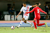 GEORGETOWN, GRAND CAYMAN, CAYMAN ISLANDS - NOVEMBER 19: Reggie Cannon #20 of the United States sends a ball downfield during a game between Cuba and USMNT at Truman Bodden Sports Complex on November 19, 2019 in Georgetown, Grand Cayman.