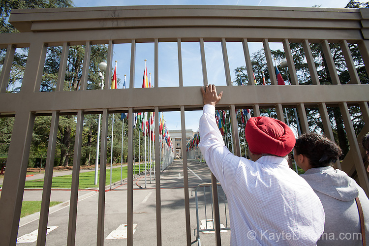 An Indian couple in front of the gate of the United Nations in Geneva, Switzerland