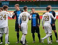 20191211- Ostend: Brugge players (left to right) Lars Dedoncker,  Maxim De Cuyper are shaking hands with Real's Pablo Ramon Parra (24), MiguelBaeza (10) and Javier Rueda Garcia at the start of the the UEFA Youth League Group A football match between Club Brugge and Real Madrid on Wednesday 11th December 2019 at Versluys Arena, Ostend, Belgium. PHOTO: SEVIL OKTEM | Sportpix.be