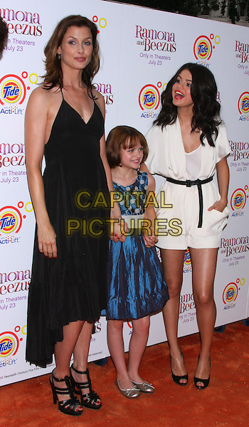 "BRIDGET MOYNAHAN, JOEY KING & SELENA GOMEZ.The Pre-Screening Meet-and-Greet for ""Ramona and Beezus"" in Madison Square Park, New York, NY, USA..July 20th, 2010.full length black dress strappy ankle sandals blue black shorts top hand in pocket peep toe shoes sash waist .CAP/LNC/TOM.©TOM/LNC/Capital Pictures."