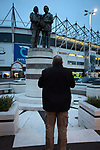 A fan looking at the statue to former managers Brian Clough and Peter Taylor outside the ground before Derby County played Stoke City in an EFL Championship match at Pride Park Stadium. Opened in 1997, it is the 16th-largest football ground in England and the 20th-largest stadium in the United Kingdom. The fixture ended in a 0-0 draw watched by a crowd of 25,685.