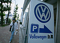 June 15, 2017, Tokyo, Japan - A man walks past a Volkswagen dealership in Tokyo, Japan. Volkswagen Group Japan senior executive Thomas Siebert was arrested for alleged illegal drug use after the German national tested postive following a drug test. (Photo by AFLO)