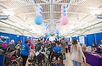NWA Democrat-Gazette/BEN GOFF @NWABENGOFF<br /> Guests visit with vendors Saturday, March 10, 2018, during the Power 105.7 Worlds Largest Baby Shower at the Jones Center in Springdale. The event sponsored by Washington Regional, with proceeds from ticket sales going to March of Dimes, included a variety of vendors, activities and seminars to help new and expecting parents provide the best care for their babies.