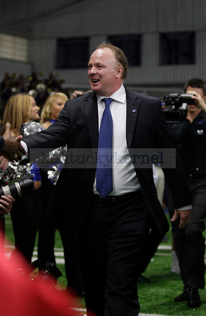 Mark Stoops enters Nutter Field during the press conference to announce his new status as football head coach in Lexington, Ky., on Sunday, December 2, 2012. Photo by Genevieve Adams | Staff