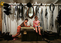 Jaiden Nichols, 4, left, and Avrie (cq) Cramer, 3, hang out at night in the Cramer Classics area behind the horse barn. August 18, 2009 PHOTO BY MERYL SCHENKER ......schenker IMG_0861_2.JPG