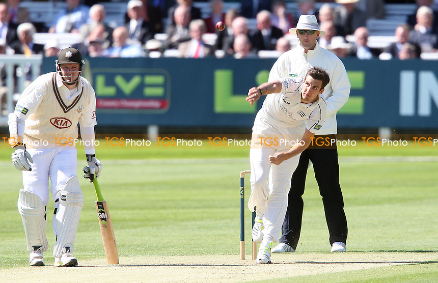 Steven Finn of Middlesex in bowling action - Middlesex CCC vs Surrey CCC, LV County Championship Division 1 at Lords, London - 02/05/13 - MANDATORY CREDIT: Rob Newell/TGSPHOTO - Self billing applies where appropriate - 0845 094 6026 - contact@tgsphoto.co.uk - NO UNPAID USE.