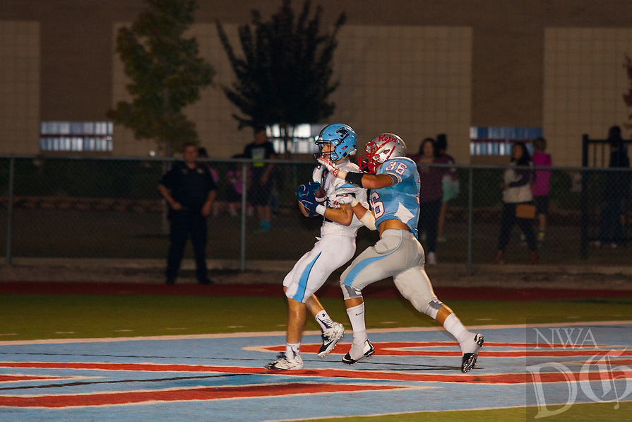 #19 Tyler Blackston of Har-Ber pulls in a TD pass during the first half.