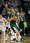 January 14, 2012:   Nevada Wolf Pack guard Deonte Burton forces Hawai'i Rainbow Warriors forward Trevor Wiseman to call a time out during their NCAA basketball game played at Lawlor Events Center on Saturday night in Reno, Nevada.