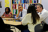 United States President Barack Obama (C) and U.S. Secretary of Education Arne Duncan (R) participate in a roundtable discussion on affordable higher education with high school students and their parents, at Washington-Lee High School in Arlington, Virginia, USA, 04 May 2012. President Obama discussed the need to prevent interest rates on federal subsidized student loans from doubling..Credit: Michael Reynolds / Pool via CNP