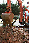Mini-excavator machine being used to repair a water main break in Atlanta.