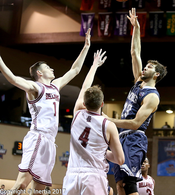 SIOUX FALLS, SD: MARCH 22: Caleb Waitsman #23 from Colorado Mines shoots over a pair of defenders including Ben Weyer #4 from Bellarmine during the Men's Division II Basketball Championship Tournament on March 22, 2017 at the Sanford Pentagon in Sioux Falls, SD. (Photo by Dave Eggen/Inertia)