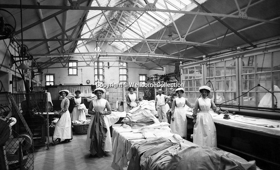 BNPS.co.uk (01202 558833)<br /> Pic: Amberley/BNPS<br /> <br /> Pictured: Nurses working in the laundry. On top of all their other duties, nurses also had to work in the kitchens and the laundry, Holloway, London in 1912.<br /> <br /> These rarely seen photos which provide a fascinating insight into British nursing in late 19th century feature in a new book.<br /> <br /> They reveal how the all-action nurses not only cared for patients but also prepared meals for them and did their laundry.<br /> <br /> Such was their ferocious work ethic, it is perhaps surprising they had time to be pictured sitting down together in the nurses dining room.<br /> <br /> One photo shows trainee nurses during a bandaging class, while another is of a busy male ward.<br /> <br /> The images are published in A History of Nursing, by former nurse Louise Wyatt who has charted the development of nursing from antiquity and the Middle Ages to the present day.