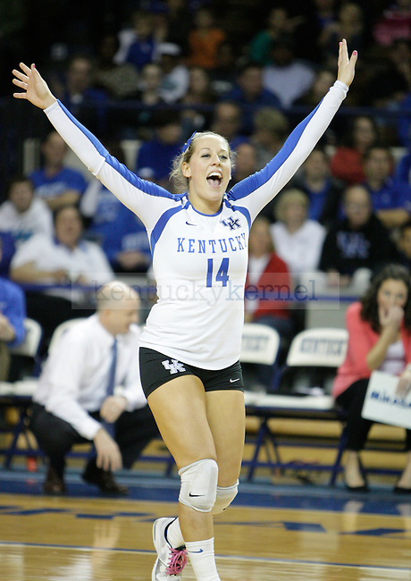 Junior Jessi Greenberg (14) celebrates after a point during the UK women's volleyball game v. East Tennessee University during the NCAA tournament in Memorial Coliseum in Lexington, Ky., on Friday, November 30, 2012. Photo by Genevieve Adams | Staff