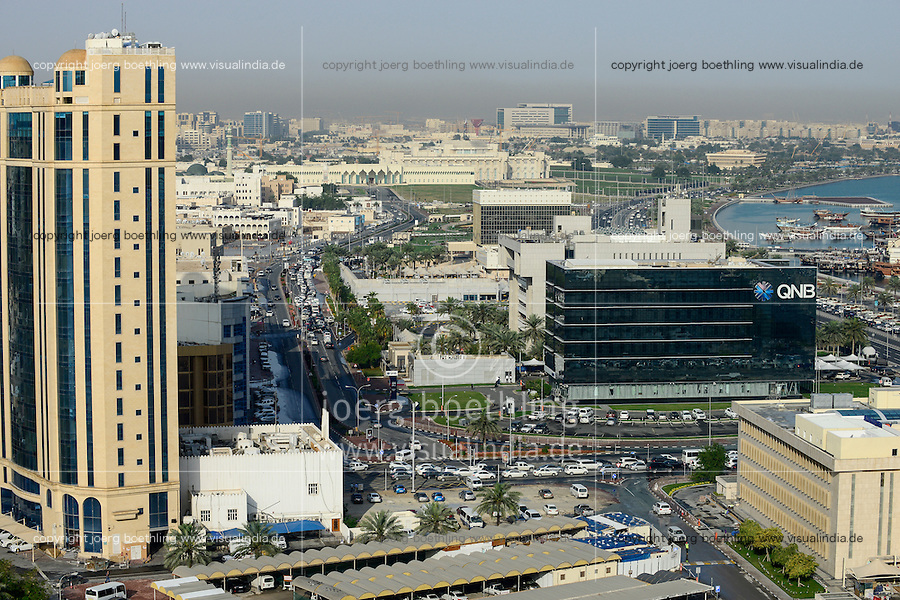 QATAR, Doha, downtown, view to  QNB QATAR National Bank, parliament and dhow harbour / KATAR, Doha, Blick zum Parlament und Bucht mit Dhau Hafen