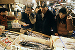 Customers haggle with a vendor over fish for sale at the Tsukiji Fish Market in Tokyo, Japan where a skilled army of licensed middlemen and buyers purchase tuna and a variety of seafood for sale in the market's 1,400 shops.  Because of the Japanese passion for freshness, all the fish sold will be consumed by Tokyo residents the following day. (Jim Bryant Photo).....
