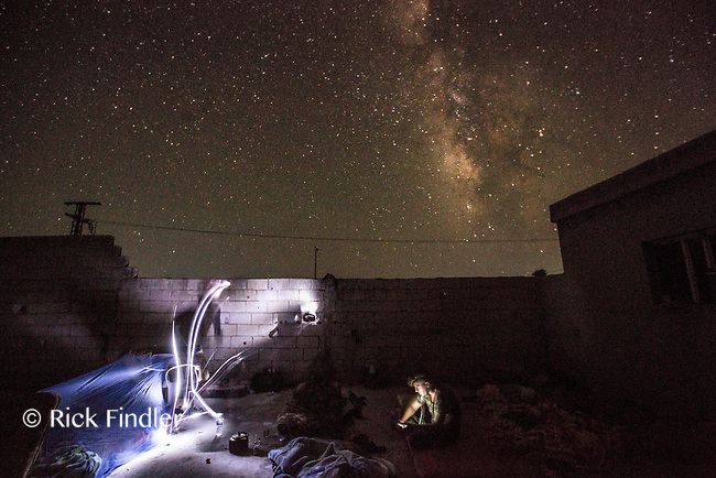August 2017. YPG Media Centre, Raqqa, Syria.<br /> Young MFS soldiers get ready for bed under the stars of Raqqa on the front lines. <br /> The MFS (Syriac Military Council) are a group of Assyrian Christians who fight alongside the Syrian Democratic Forces in the fight to topple ISIS.<br /> Photographer: Rick Findler