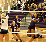 SIOUX FALLS, SD - SEPTEMBER 19:  Sydney Hunsley #8 from Augustana looks for the block against Bria Barfnecht #15 from the University of Sioux Falls during their match Saturday afternoon at the Stewart Center. (Photo by Dave Eggen/Inertia)