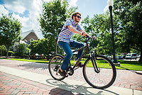 Ben Caldwell, a spring 2017 Mississippi State MBA graduate from Madison, rides his bike across campus on a warm summer day. The two-time MSU graduate plans to move to Asheville, North Carolina, this summer.  <br />