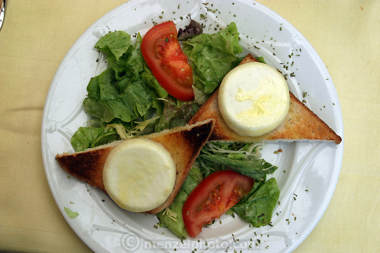 Warm goat cheese, toast points, and salad for lunch in a restaurant on the Rue Maubourg Paris, France. (Supporting image from the project Hungry Planet: What the World Eats)