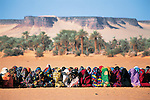 Gouro, northern Chad. Women in colorful robes pray separated from the men during celebration of Eid al-Fitr, the day after Ramadan.