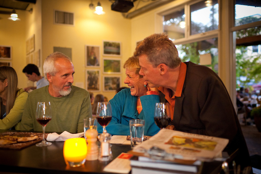 Santa Rosa residents, Jimmy DePriest, left, and Rhoann Ponseti, with her husband, Stefan Jonson, dine at Peter Lowell's restaurant, which supports and use produce from sustainable farms, including their own, Two Belly Acres, in Sebastopol, on Saturday, Oct. 9, 2011. In recent years, new restaurants, shops and live music venues have opened in Sebastopol, securing the town as an arts and culture hub.